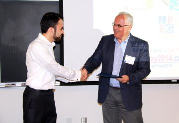 Alireza Bagherzadeh receives his Graduate Student Leadership award from Dr. Peter Englezos